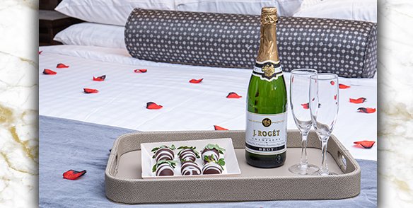 romance package - chocolate covered strawberries, champagne and rose petals