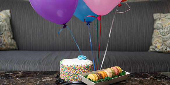 celebraton package - cake, macarons, balloons - preset amenities