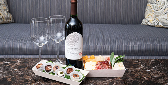 epicurean package - francisican red wine, gourmet cheese meats, and truffle chocolates - preset amenities