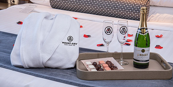 2021 Amenities | roses, 2 robes, petit fours, and champagne
